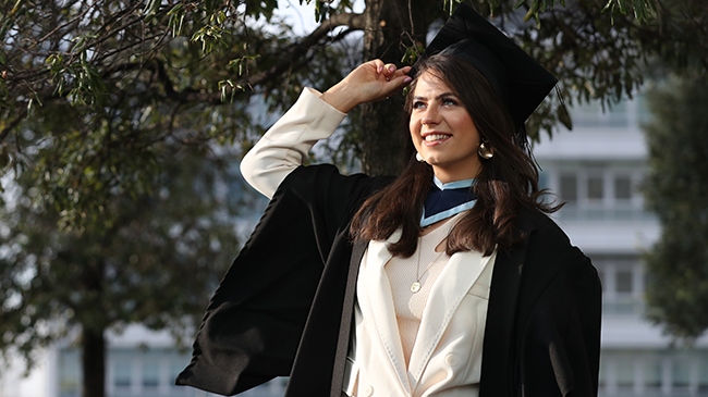 Female graduate in her robes